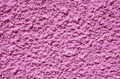 Pink rough plaster on wall Royalty Free Stock Photos