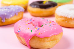 Pink round donut on pastele background. Closeup Stock Photography