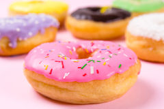 Pink round donut on pastele background. Closeup Royalty Free Stock Photo