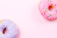 Pink round donut on pastele background. Flat lay, top view. Stock Images