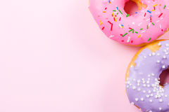 Pink round donut on pastele background. Flat lay, top view. Royalty Free Stock Photography