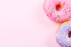 Pink round donut on pastele background. Flat lay, top view. Stock Image