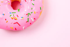 Pink round donut on pastele background. Flat lay, top view. Royalty Free Stock Images
