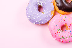 Pink round donut on pastele background. Flat lay, top view. Royalty Free Stock Photos