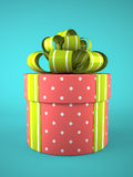 Pink round gift box on blue background Stock Photos