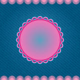 Pink Round Label on Denim Blue Background Royalty Free Stock Photos