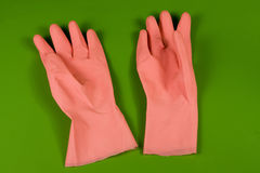 Pink rubber gloves Stock Photos