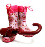 Pink rubber knee-boots and umbrella Royalty Free Stock Photos