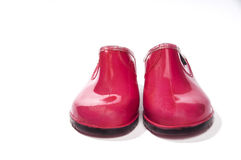 Pink rubber shoes facing forward Royalty Free Stock Image