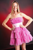 Pink ruffles. Blond woman in pink ruffles Royalty Free Stock Images