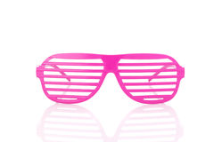 Pink 80's slot glasses isolated on white background. Hot pink 80's slot glasses isolated on white background front view stock photos