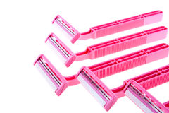 Pink safety razors. On white background Royalty Free Stock Photos