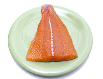 Pink salmon fillet. Fillet of salmon pink on green plate Royalty Free Stock Images