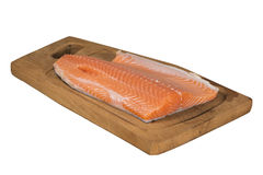 Pink Salmon 03. Raw pink salmon on a wooden chopping board, isolated over white with clipping path Royalty Free Stock Photography