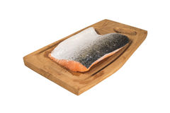 Pink Salmon 02. Raw pink salmon on a wooden chopping board, isolated over white with clipping path Stock Photography