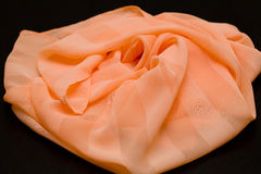 Pink, salmon silk tender colored textile, elegance rippled material Stock Photos