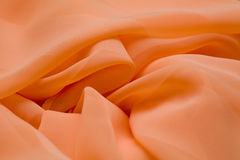 Pink, salmon silk tender colored textile, elegance rippled material Stock Image