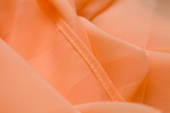 Pink, salmon silk tender colored textile, elegance rippled material. Fabric and tissue Royalty Free Stock Photos