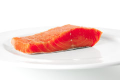 Pink salmon on white plate Stock Photography