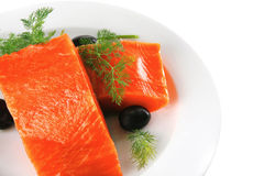 Pink salmon on white plate with olives Stock Photography