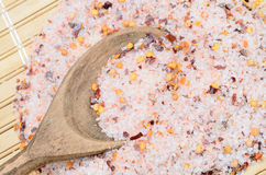 Pink salt with chili seed on table stock image