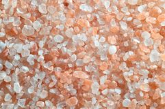 Pink salt from the Himalaya - background. Closeup of salt crystals Royalty Free Stock Image