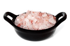 Pink Salt from the Himalayas. Special pink salt from the Himalayas, in a small black bowl isolated on white Royalty Free Stock Photography