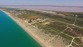 Pink salt lakes and turquoise sea, aerial video. Overflight along places of tourist stay near pink salt lakes and turquoise sea, aerial video stock video footage