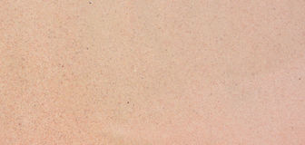 Pink sand texture. Pink background. Natural color texture of sea sand Stock Photos