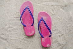 Pink sandal on sandy beach Stock Images