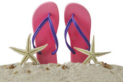 Pink sandal and starfishes on sand Royalty Free Stock Photography
