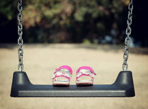 Pink sandals on swing Royalty Free Stock Photo