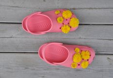 Pink sandals with yellow flowers Stock Photography