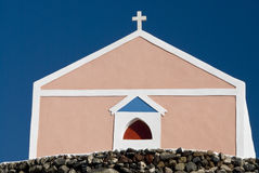 Pink Santorini Church on a Hillside Stock Photos