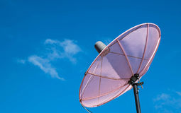 Pink Satellite on the roof with the sky background. Stock Photos