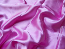 Pink Satin. Beautiful lustrous pink satin fabric background Royalty Free Stock Image