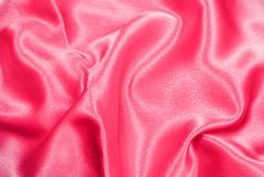 Pink satin. Beautiful and shiny pink satin background - for romantic designs Stock Image