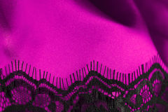 Pink satin with black lace Stock Photos