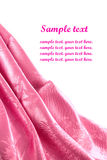 Pink satin fabric. With beautiful patterns of folds Stock Images