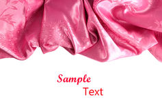 Pink satin fabric against. White background Stock Photography