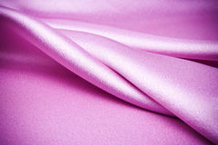 Pink satin fabric, it waves. Stock Images