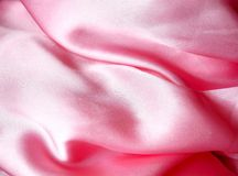 Pink satin. With folds, texture Royalty Free Stock Photo