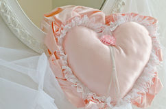 Pink Satin Heart Pillow and Vintage Mirror Stock Images