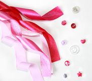 Pink satin ribbon and buttons. On white background Stock Image
