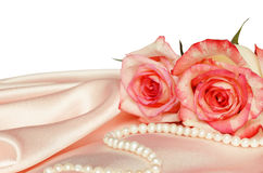 Pink satin and roses Stock Images