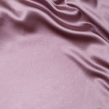 Pink satin or silk fabric background Royalty Free Stock Photos