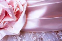 Pink satin wedding dress detail. Violet and pink beautiful wedding dress detail stock photos