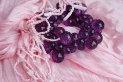 Pink scarf and purple bracelet. Accessories for women, pink scarf and purple bracelet stock photos