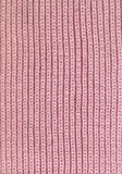 Pink scarf texture. Texture of a knitted scarf made of pink colored wool Royalty Free Stock Photography