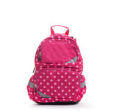 Pink school backpack with white dots isolated on white.  royalty free stock photo